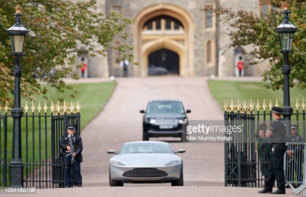 Jack Brooksbank and Princess Eugenie drive out of Windsor Castle in an Aston Martin DB10 following their wedding ceremony at St George's Chapel,...