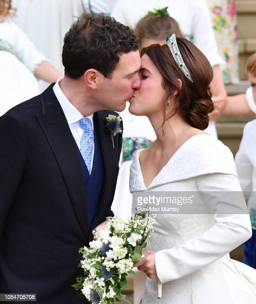 Jack Brooksbank and Princess Eugenie kiss as they leave St George's Chapel following their wedding ceremony on October 12, 2018 in Windsor, England.