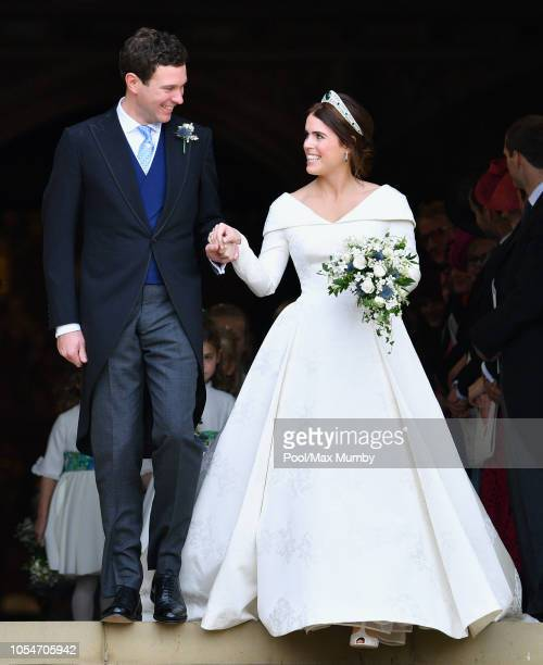 Jack Brooksbank and Princess Eugenie leave St George's Chapel after their wedding ceremony on October 12 2018 in Windsor England