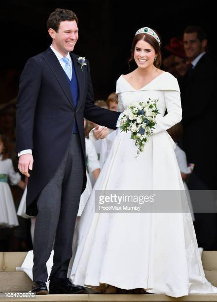 Jack Brooksbank and Princess Eugenie leave St George's Chapel after their wedding ceremony on October 12, 2018 in Windsor, England.