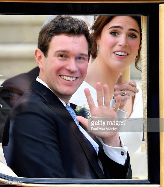 Jack Brooksbank and Princess Eugenie leave St George's Chapel, in the Scottish State Coach, to begin their horse drawn carriage procession after...