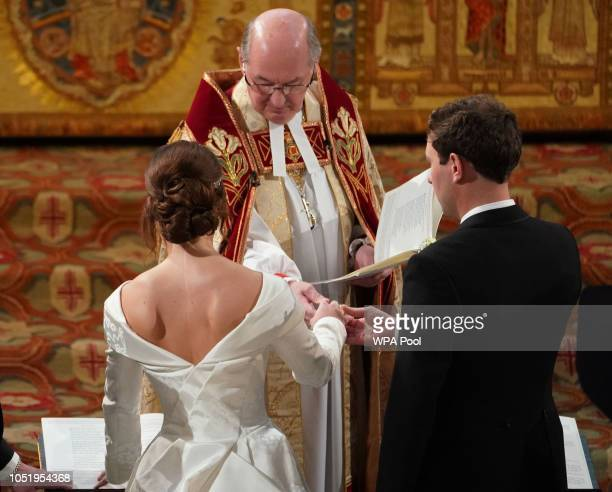 Jack Brooksbank and Princess Eugenie of York during their wedding ceremony at St George's Chapel on October 12 2018 in Windsor England