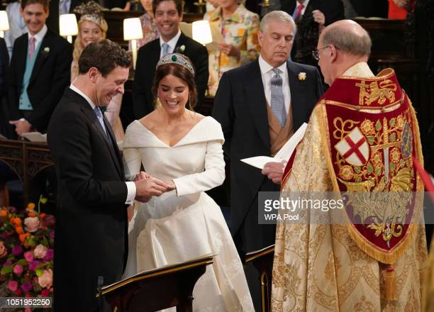 Jack Brooksbank and Princess Eugenie of York exchange rings during their wedding ceremony at St George's Chapel on October 12 2018 in Windsor England