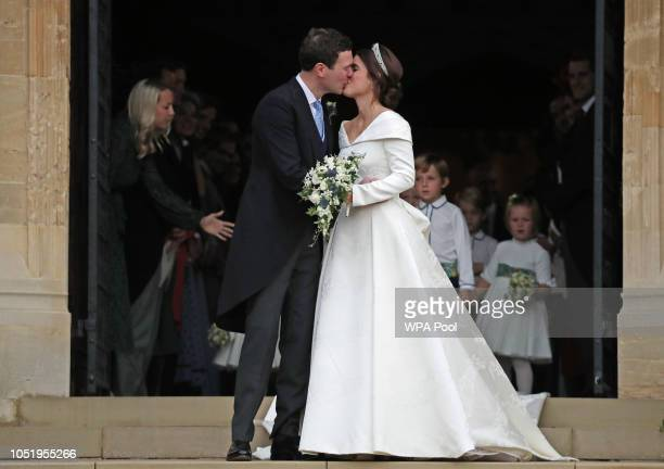 Jack Brooksbank and Princess Eugenie of York kiss on the steps of St George's Chapel after their wedding ceremony at St George's Chapel on October 12...