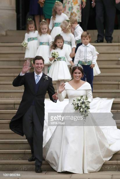 Jack Brooksbank and Princess Eugenie of York walk down the steps followed by their page boys and bridesmaids after their wedding ceremony at St...