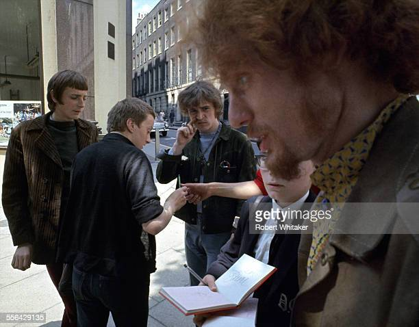 Jack Bruce and Ginger Baker of Cream pictured signing autographs following a recording session at the BBC's Playhouse Theatre May 1967