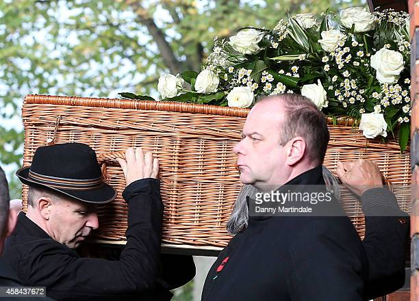 Jack Bruce coffin is carried in to the Crematorium by his son Malcolm Bruce at the funeral of Jack Bruce at Golders Green Crematorium on November 5...