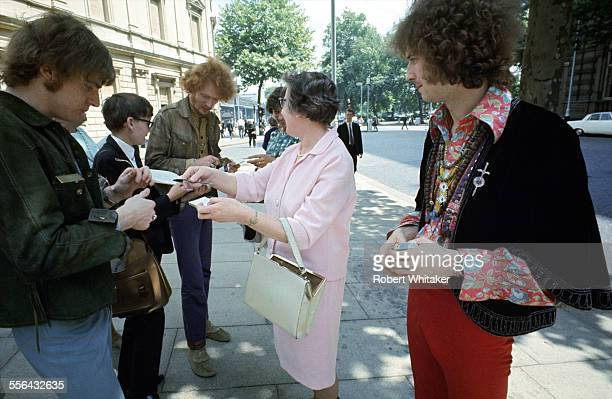 Jack Bruce Ginger Baker and Eric Clapton of Cream pictured signing autographs following a recording session at the BBC's Playhouse Theatre May 1967