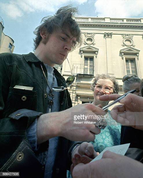 Jack Bruce of Cream pictured signing autographs following a recording session at the BBC's Playhouse Theatre May 1967