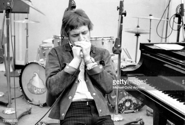 Jack Bruce of the rock band Cream records harmonica at the Strange Brew recording session at Atlantic Recording Studios on April 5 1967 in New York...