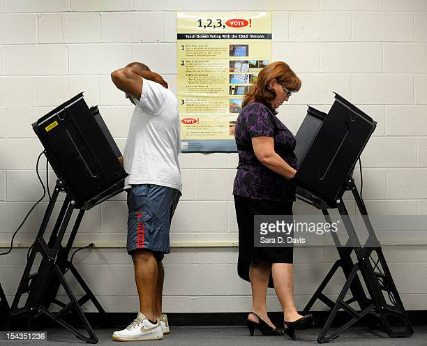 Jack Bunn and Jane Cookson both of Wilson North Carolina cast their votes at the Board of Elections early voting station on October 18 2012 in Wilson...