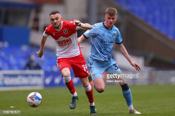 Jack Burroughs of Coventry City in action with Scott Malone of Millwall during the Sky Bet Championship match between Coventry City and Millwall at...