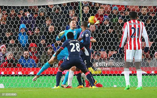 Jack Butland goalkeeper of Stoke City makes a late save from Seydou Doumbia of Newcastle United during the Barclays Premier League match between...