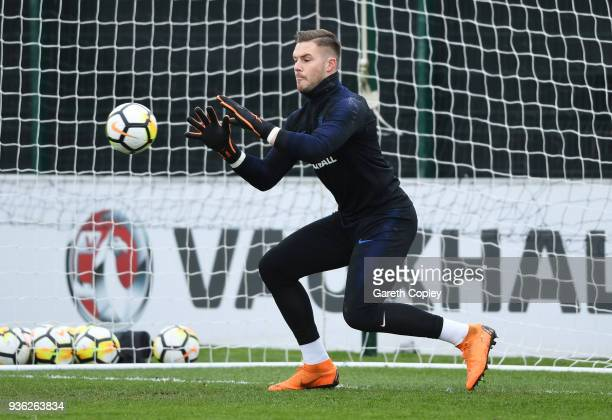 Jack Butland makes a save during an England training session on the eve of their international friendly against the Netherlands at St Georges Park on...