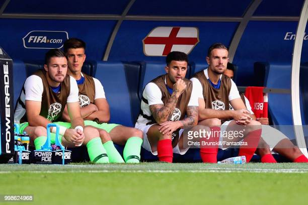 Jack Butland Nick Pope Kyle Walker and Jordan Henderson all of England watch the action from the substitutes bench during the 2018 FIFA World Cup...