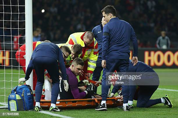 Jack Butland of England is carried by a stretcher after injury during the International Friendly match between Germany and England at Olympiastadion...