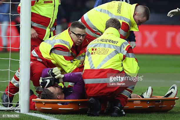 Jack Butland of England is carried off the pitch by a stretcher after injury during the International Friendly match between Germany and England at...