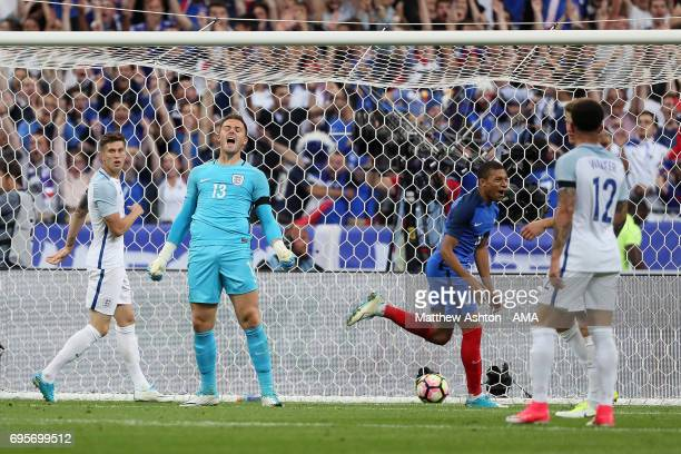 Jack Butland of England reacts after Ousmane Dembele of France scored a goal to make the score 32 during the International Friendly match between...