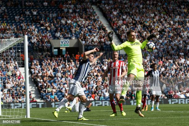 Jack Butland of Stoke City and Jay Rodriguez of West Bromwich Albion during the Premier League match between West Bromwich Albion and Stoke City at...