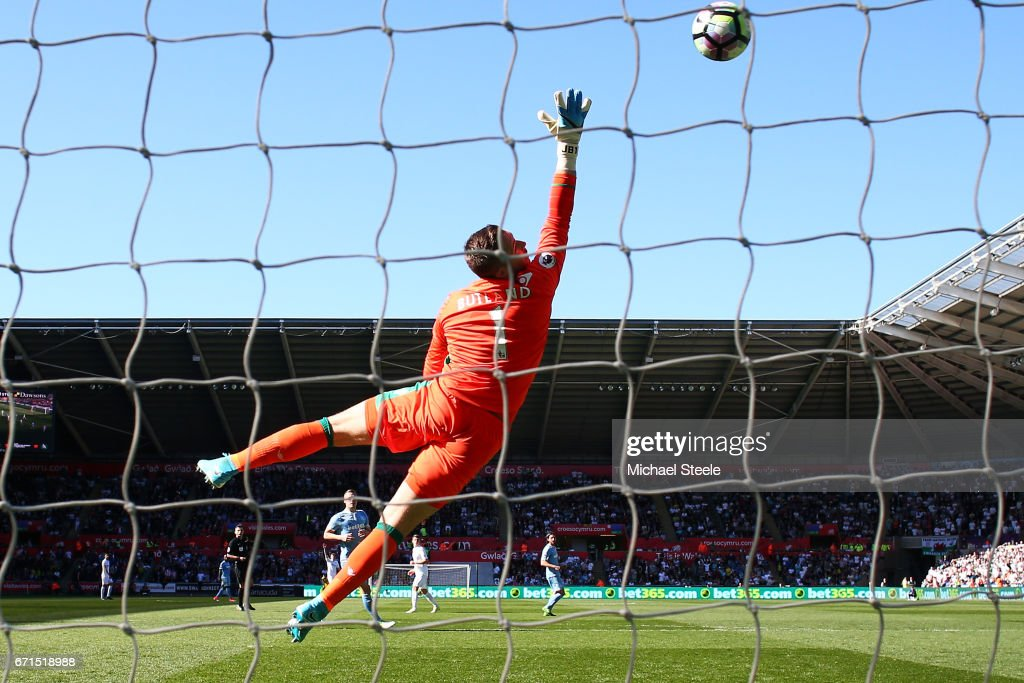 Jack Butland of Stoke City attempts to save as Tom Carroll of Swansea City (Not Pictured) scores his sides second goal during the Premier League match between Swansea City and Stoke City at the Liberty Stadium on April 22, 2017 in Swansea, Wales.