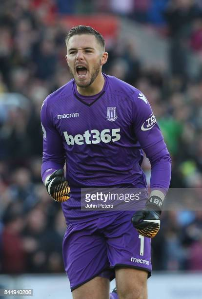 Jack Butland of Stoke City celebrates Maxim ChoupoMoting scoring their first goal their first goal during the Premier League match between Stoke City...