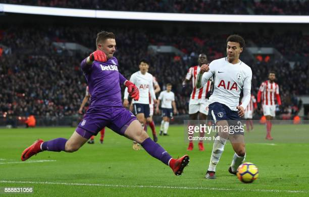 Jack Butland of Stoke City comes out to the ball putting Dele Alli of Tottenham Hotspur under pressure during the Premier League match between...