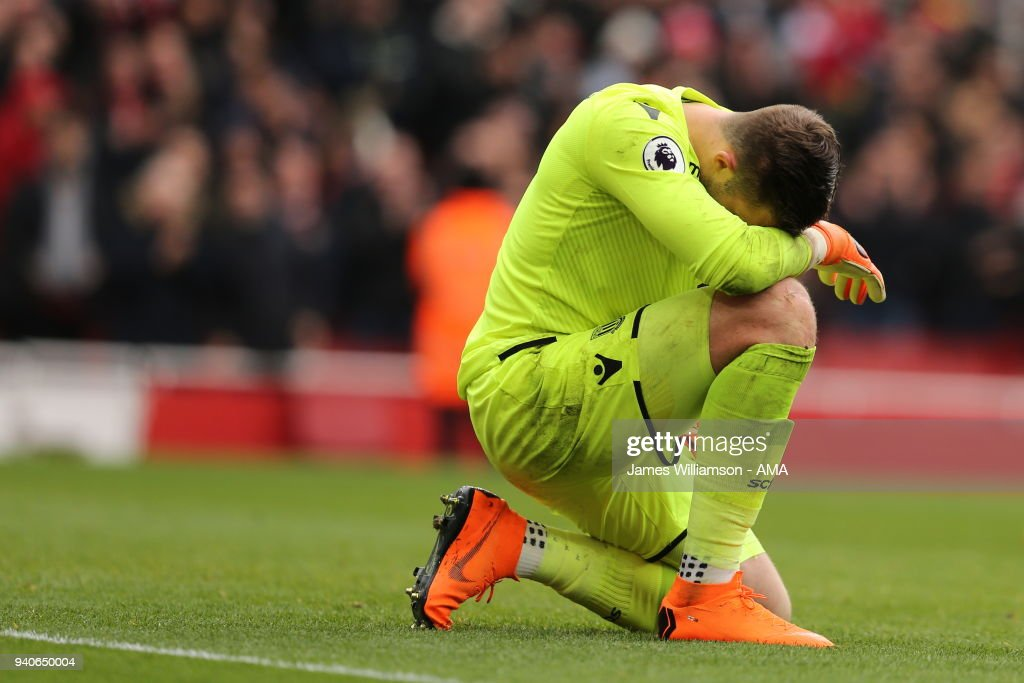 Jack Butland of Stoke City dejected after conceeding a second goal during the Premier League match between Arsenal and Stoke City at Emirates Stadium on April 1, 2018 in London, England.