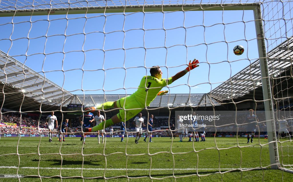 Jack Butland of Stoke City dives to make a save during the Premier League match between Swansea City and Stoke City at Liberty Stadium on May 13, 2018 in Swansea, Wales.