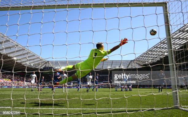 Jack Butland of Stoke City dives to make a save during the Premier League match between Swansea City and Stoke City at Liberty Stadium on May 13 2018...