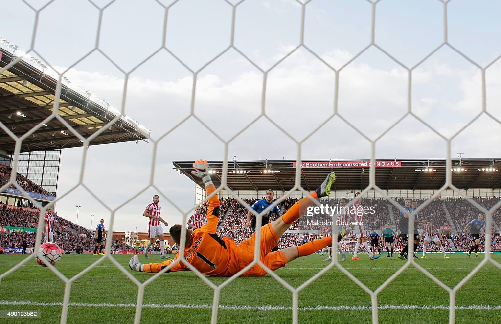 Jack Butland of Stoke City fails to stop the Bournemouth's first goal by Dan Gosling during the Barclays Premier League match between Stoke City and A.F.C. Bournemouth at Britannia Stadium on September 26, 2015 in Stoke on Trent, United Kingdom.