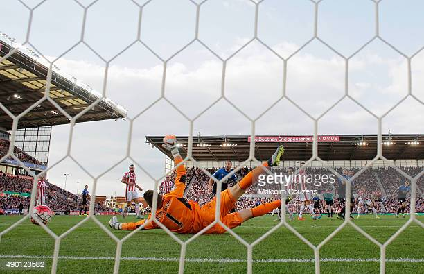 Jack Butland of Stoke City fails to stop the Bournemouth's first goal by Dan Gosling during the Barclays Premier League match between Stoke City and...