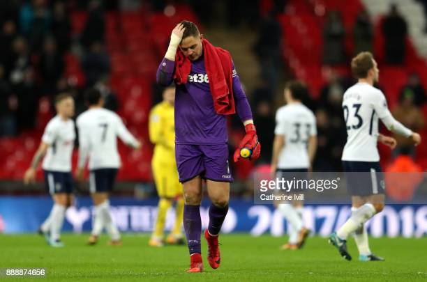Jack Butland of Stoke City look dejected after the Premier League match between Tottenham Hotspur and Stoke City at Wembley Stadium on December 9...