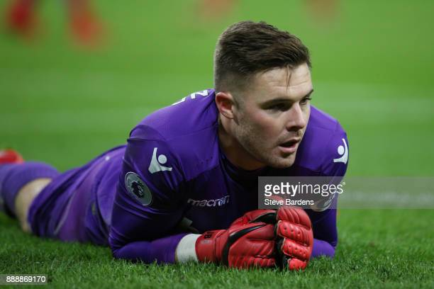 Jack Butland of Stoke City look dejected during the Premier League match between Tottenham Hotspur and Stoke City at Wembley Stadium on December 9...