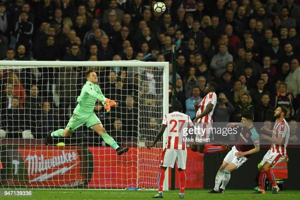 Jack Butland of Stoke City makes a save from Declan Rice of West Ham United during the Premier League match between West Ham United and Stoke City at...