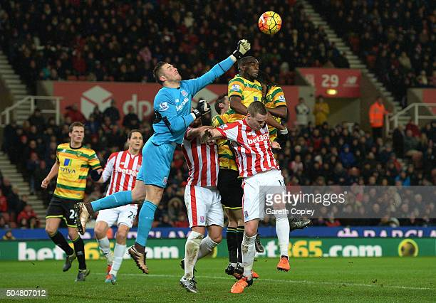 Jack Butland of Stoke City punches the ball during the Barclays Premier League match between Stoke City and Norwich City at the Britannia Stadium on...