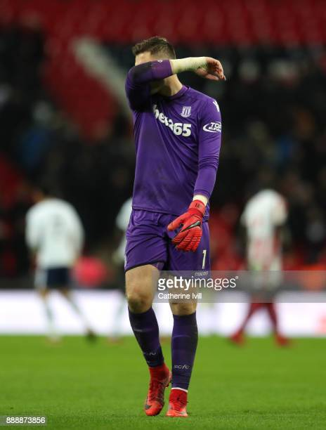 Jack Butland of Stoke City reacts during the Premier League match between Tottenham Hotspur and Stoke City at Wembley Stadium on December 9 2017 in...