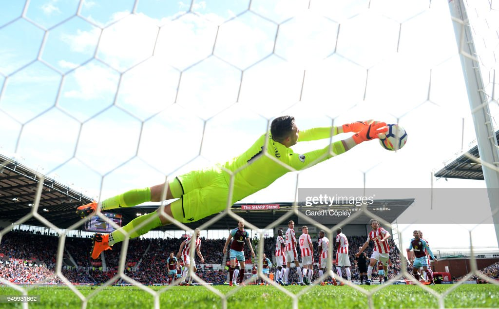 Jack Butland of Stoke City saves a free kick from Johann Gudmundsson of Burnley during the Premier League match between Stoke City and Burnley at Bet365 Stadium on April 22, 2018 in Stoke on Trent, England.