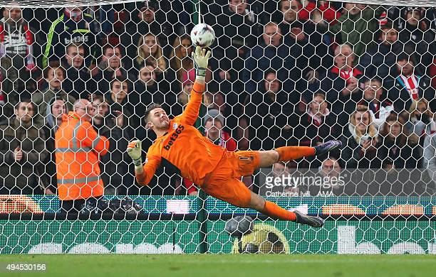 Jack Butland of Stoke City saves the penalty from Eden Hazard of Chelsea to win the match during the Capital One Cup Fourth Round match between Stoke...