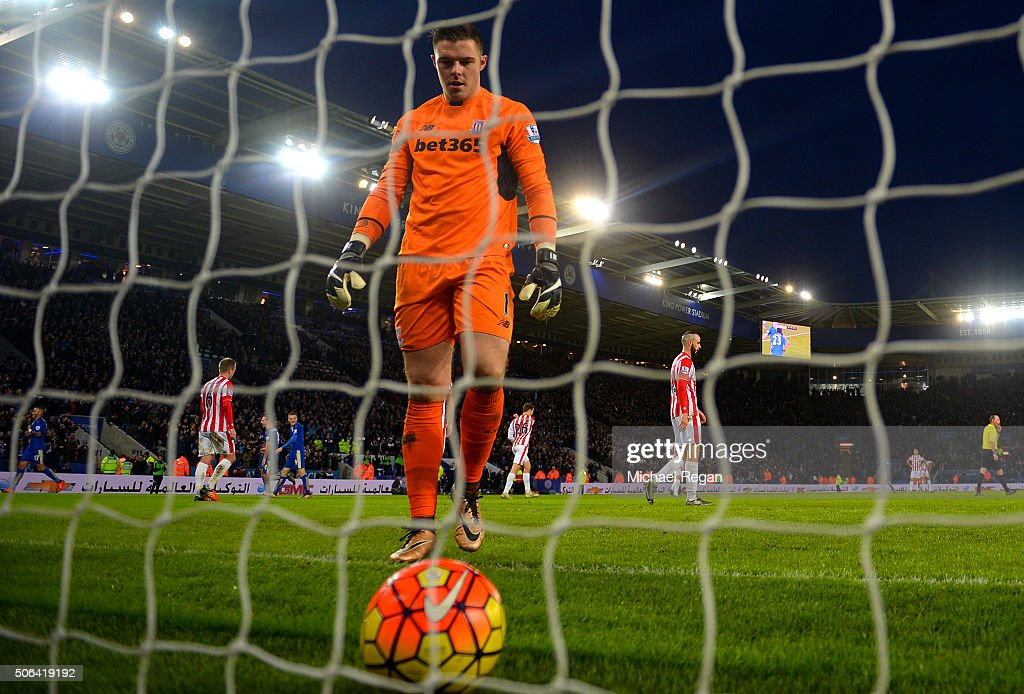 Jack Butland of Stoke City walks to pick up the ball after Leonardo Ulloa of Leicester City scoring the third goal during the Barclays Premier League match between Leicester City and Stoke City at The King Power Stadium on January 23, 2016 in Leicester, England.