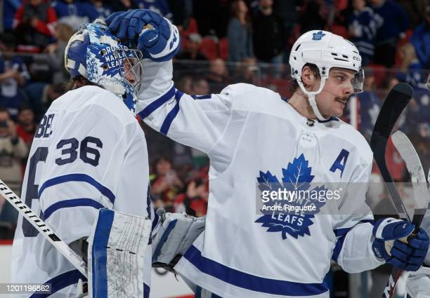 Jack Campbell and Auston Matthews of the Toronto Maple Leafs celebrate their 42 win over the Ottawa Senators at Canadian Tire Centre on February 15...