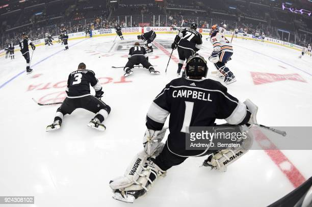 Jack Campbell and Dion Phaneuf of the Los Angeles Kings warm up before a game against the Edmonton Oilers at STAPLES Center on February 24 2018 in...