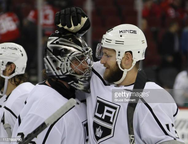 Jack Campbell and Kyle Clifford of the Los Angeles Kings celebrate a 51 victory over the New Jersey Devils at the Prudential Center on February 05...