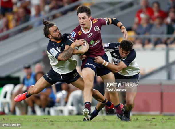 Jack Campbell of Reds is tackled by Andy Muirhead and Tom Banks during the round eight Super RugbyAU match between the Queensland Reds and the ACT...