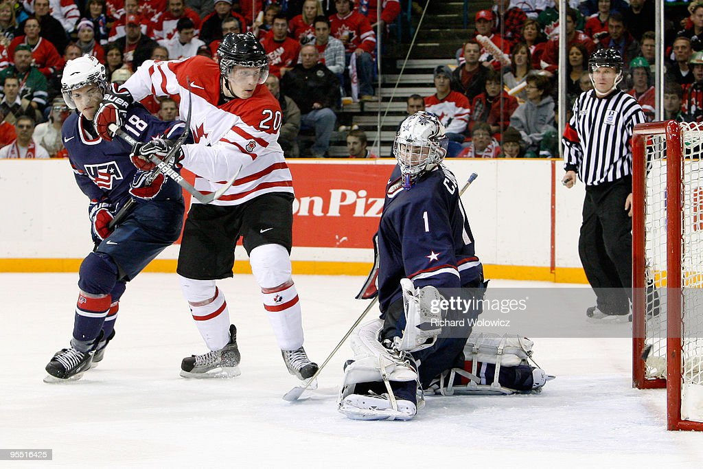 Jack Campbell #1 of Team USA lets in a goal in front of Luke Adam #20 of Team Canada and Brain Lashoff #18 during the 2010 IIHF World Junior Championship Tournament game on December 31, 2009 at the Credit Union Centre in Saskatoon, Saskatchewan, Canada. Team Canada defeated Team USA 5-4 in a shootout.