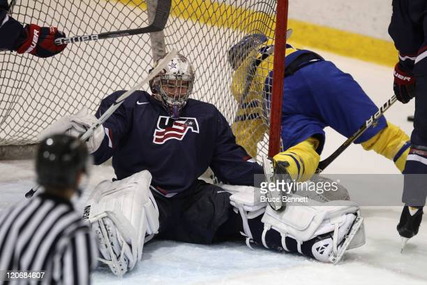 Jack Campbell of Team USA makes the save against Team Sweden at the Lake Placid Olympic Center on August 8 2011 in Lake Placid New York
