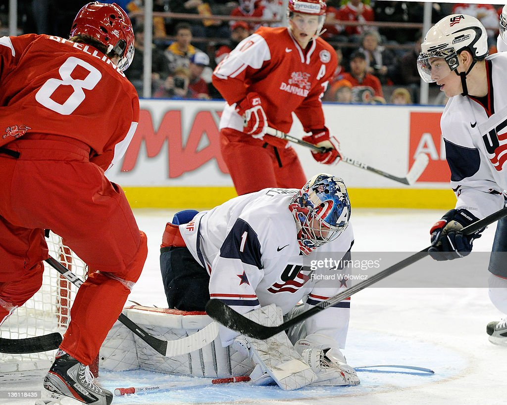 Jack Campbell #1 of Team USA stops the puck on an attempt by Thomas Spelling #8 of Team Denmark during the 2012 World Junior Hockey Championship game at Rexall Place on December 26, 2011 in Edmonton, Alberta, Canada.