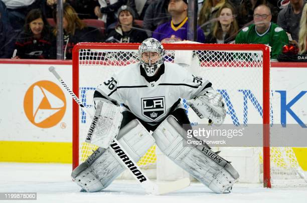 Jack Campbell of the Los Angeles Kings crouches in the crease to protect the net during an NHL game against the Carolina Hurricanes on January 11...