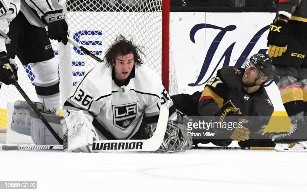 Jack Campbell of the Los Angeles Kings gets up after Shea Theodore of the Vegas Golden Knights tripped over him as Campbell made a save in the first...