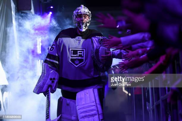 Jack Campbell of the Los Angeles Kings high fives fans prior to the third period against the Winnipeg Jets at STAPLES Center on November 30 2019 in...