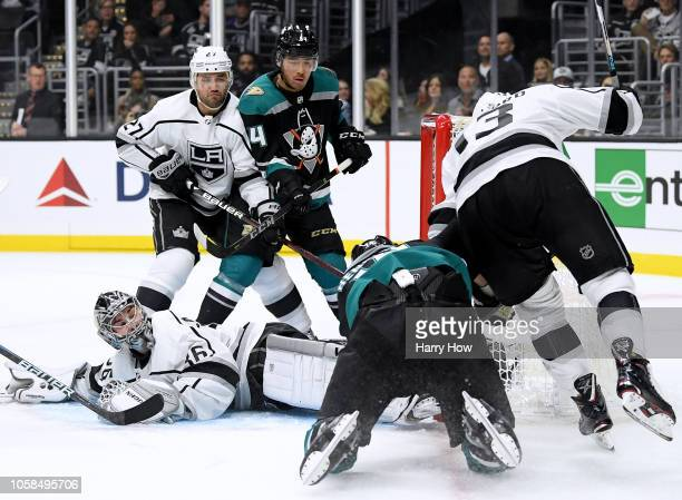 Jack Campbell of the Los Angeles Kings looks back for the puck as he makes a save on Adam Henrique of the Anaheim Ducks as Kyle Clifford Alec...